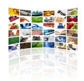 Wall of tv screens. Large wall of tv screens with various images Royalty Free Stock Photo