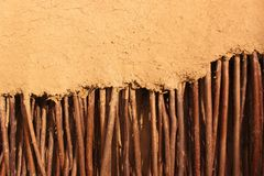 Wall of twigs wrapped in clay Stock Images