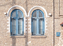Wall with two blue windows Royalty Free Stock Photography
