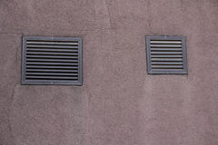 Wall with two gratings. Pink wall with gratings Royalty Free Stock Images