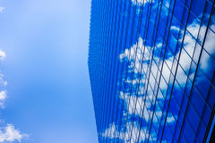 The wall of an urban building shows a blue sky Stock Photo