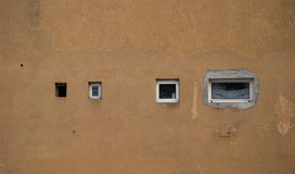 Wall and variety of windows. House back wall and variety of small windows stock images