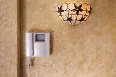 Wall with  video intercom equipment and lamp Royalty Free Stock Photography