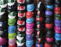 Wall of Vietnamese scooter helmets at a stall stock images