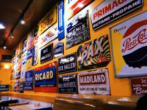 Wall of vintage signs stock photography