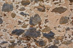 Wall of volcanic rocks. the wall of an old house made of volcanic rock. stock photos