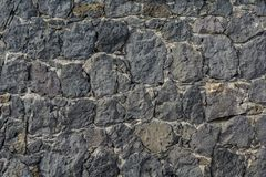 Wall of volcanic rocks Royalty Free Stock Photo