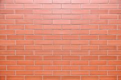 Wall. With ceramic tiles in the form of brick Stock Image