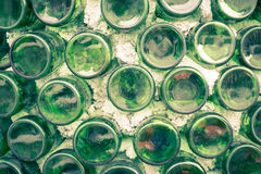 Wall of warehouse with many bottles Selective focus. form dust o. Ld cork bar row pile line rack wet vine ripe noir shot beer indoors green factory dark winery Royalty Free Stock Photos