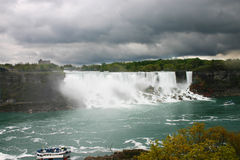 Wall of water. Majestic fall of water with ship called maid of the mist Stock Photography