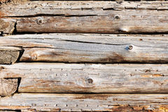 Wall from weathered old logs with cracks. Grunge background Stock Image