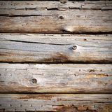 Wall from weathered old logs with cracks. Grunge background Royalty Free Stock Photos