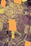 Wall weathered stone with yellow elements for your background royalty free stock image