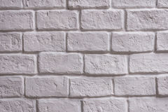 A wall of white brick aging by time and faded by wheather. A stone work and background for house design Stock Photos