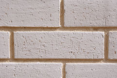 Wall of white bricks with yellow fugue Stock Photos