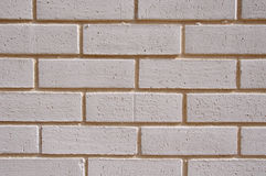 Wall of white bricks with yellow fugue Royalty Free Stock Photography