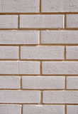 Wall of white bricks with yellow fugue stock photography