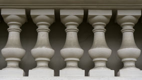 Wall of white columns Stock Images