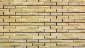 Wall of a wild yellow decorative stone. A wall of a wild yellow decorative stone Royalty Free Stock Photos