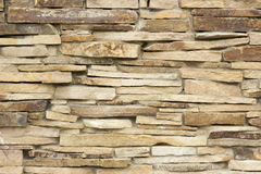 Wall of a wild yellow decorative stone. A wall of a wild yellow decorative stone Stock Photography