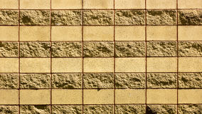 A wall of a wild yellow decorative stone. Wall of a wild yellow decorative stone Royalty Free Stock Image