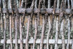 Wall of willow twigs as background. Rural old fence, made from willow tree twigs and branches. royalty free stock photo