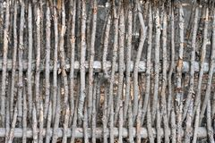 Wall of willow twigs as background. Rural old fence, made from willow tree twigs and branches royalty free stock photography