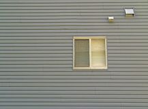 Wall with Window. An exterior sided wall with a window Royalty Free Stock Photos