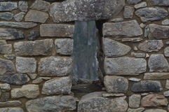 Wall. Window in a hand made stone wall from a house in the ruins of Machu Pichu in Peru Stock Photo
