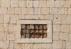 Wall, window, iron grid Stock Photography