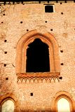 A wall with a window that looks like a painting in the castle of Vigevano near Pavia in Lombardy (Italy). Photo made at the castle of Vigevano near Pavia in stock photos