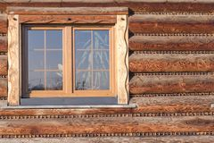 Wall with window of modern wooden log house in village royalty free stock image