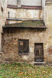 Wall and window of the old abandoned house in Vilnius, Lithuania Stock Photos