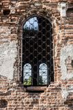 wall with a window of an old destroyed church Stock Photos