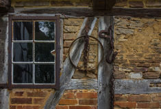 The wall and window of an old farmhouse Royalty Free Stock Image