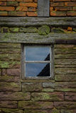 The wall and window of an old farmhouse Stock Image