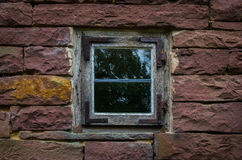 The wall and window of an old farmhouse Royalty Free Stock Photos