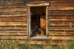 The wall and window of an old house Stock Images