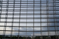 Wall of windows. A large curved wall of windows with geometric steel structural supports Stock Photos
