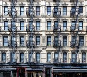 Wall of windows on an old apartment building in the Lower East S stock image