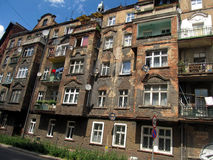 Wall with windows of an old, damaged residential building in Wro Stock Image
