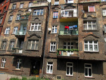 Wall with windows of an old, damaged residential building in Wro Stock Photography