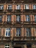 Wall with windows of an old, damaged residential building in Wro Royalty Free Stock Photo
