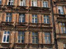 Wall with windows of an old, damaged residential building in Wro Stock Photos