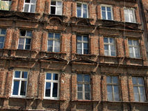 Wall with windows of an old, damaged residential building in Wro Royalty Free Stock Image