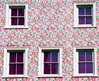 Wall and windows: pink, purple and flowers!. Five windows and a flower colored wall. Predominant colors: violet, magenta and pink Stock Image