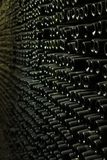 Wall of empty wine bottle royalty free stock images