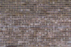 Wall and Wire. A Brick and mortar wall with a telephone wire running across it stock photo