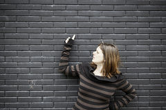 Wall woman points Royalty Free Stock Image