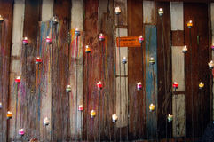 Wall with wood and candle. Royalty Free Stock Images